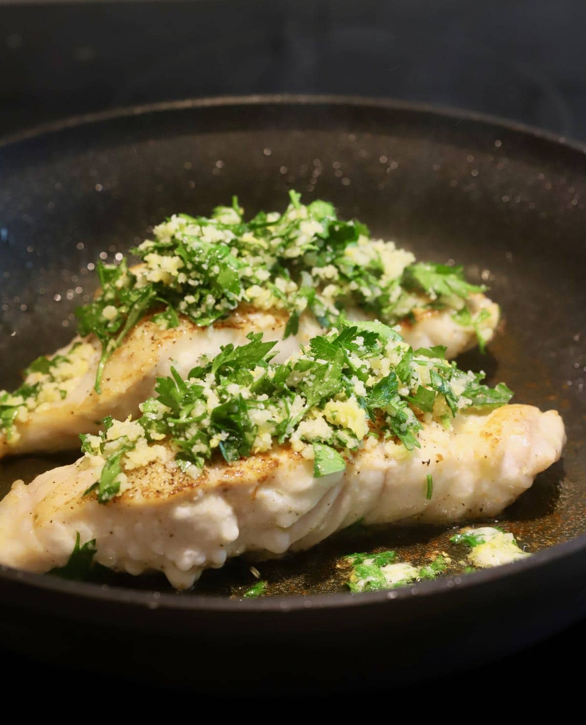 Two grouper fillets topped with a gremolata mixture.