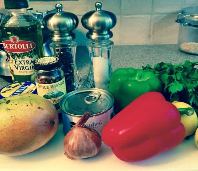 Mango salsa ingredients including mango, red bell pepper, shallots and parsley.