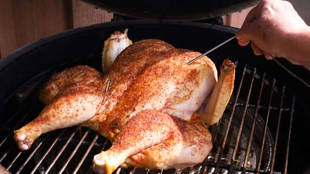 Smoking a chicken on a green egg.