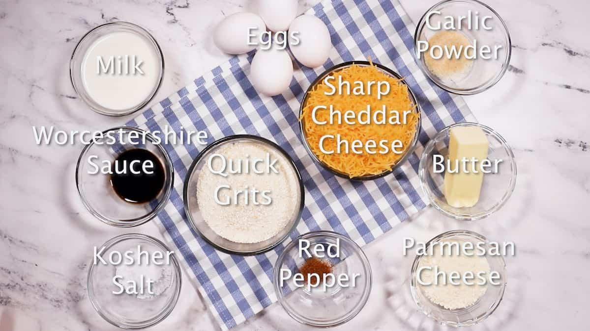 Bowls of raw quick grits, cheddar cheese, salt and garlic powder.
