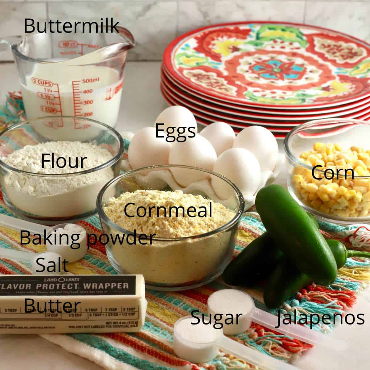 Cornbread ingredients including flour, cornmeal and eggs.