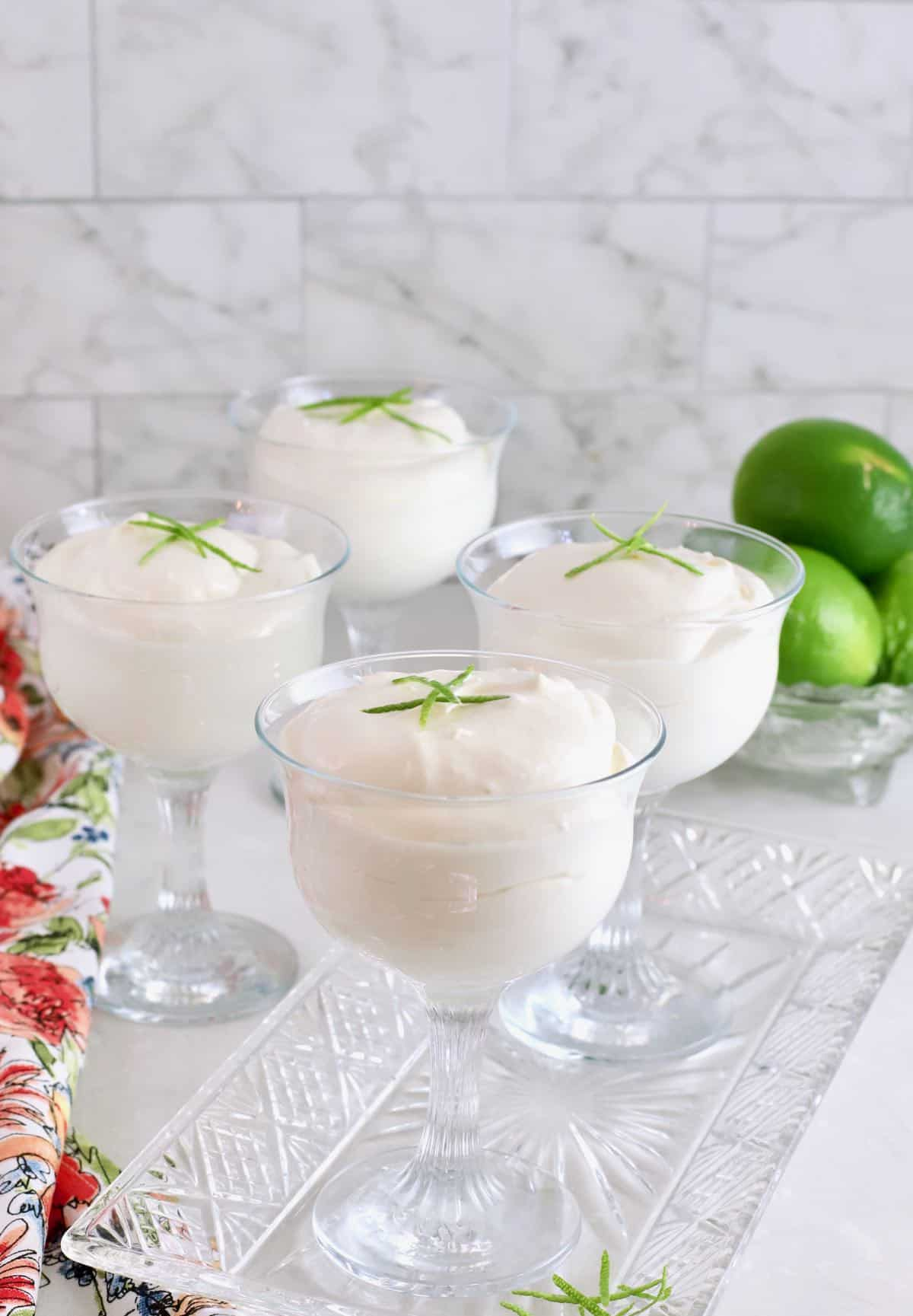 Four glass dessert cups with Key Lime Mousse.