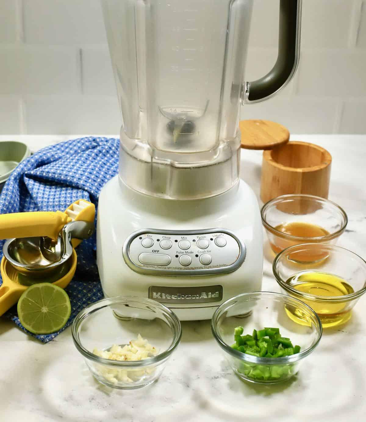 A blender with salad dressing ingredients.