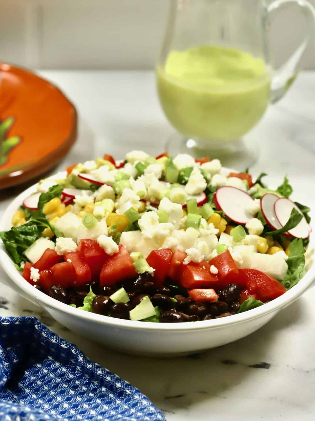 Mexican chopped salad in a white bowl.