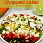 Pinterest pin showing a Mexican chopped salad in a white bowl.