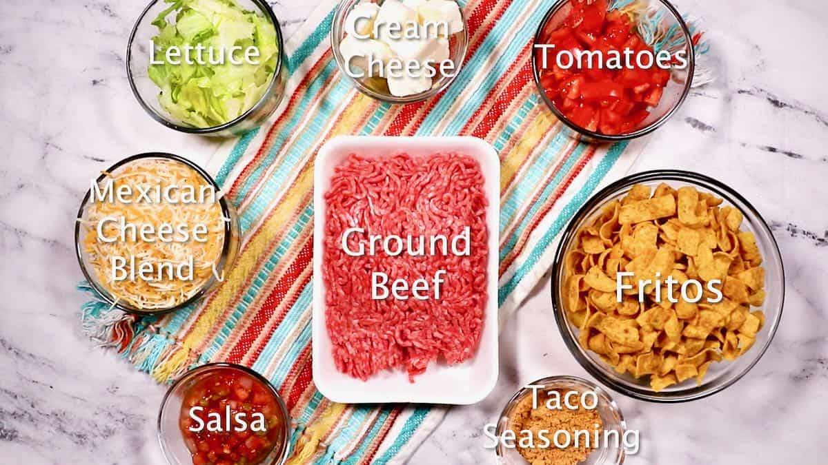 Ingredients including ground beef, cheese and Fritos to make walking tacos.