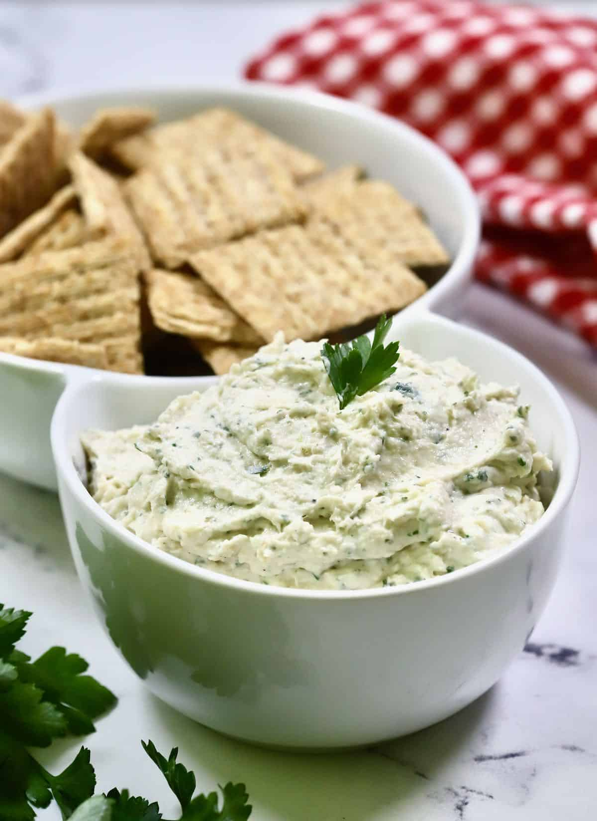 Chicken Ranch Dip with Triscuits in a serving bowl.