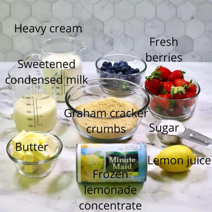Ingredients for frozen lemonadee pie including graham cracker crumbs and frozen lemonade.
