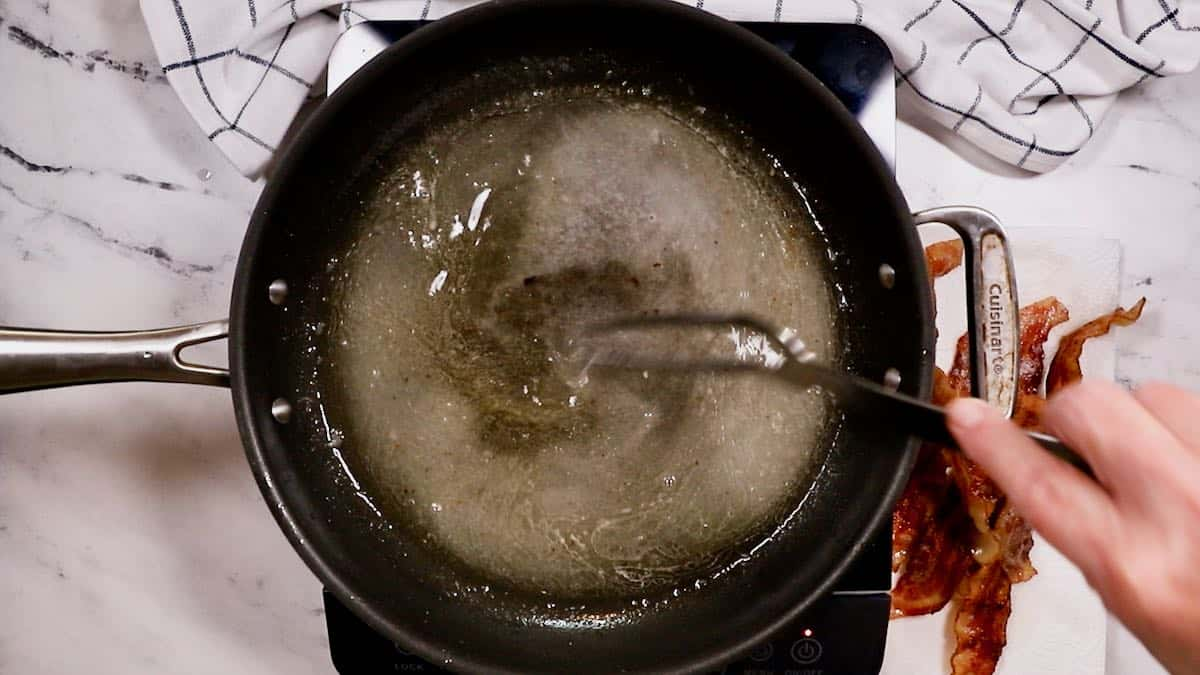 Sugar and vinegar cooking in a skillet.