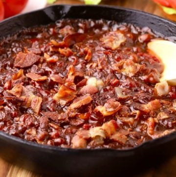 Smoked Baked Beans in a cast-iron skillet.
