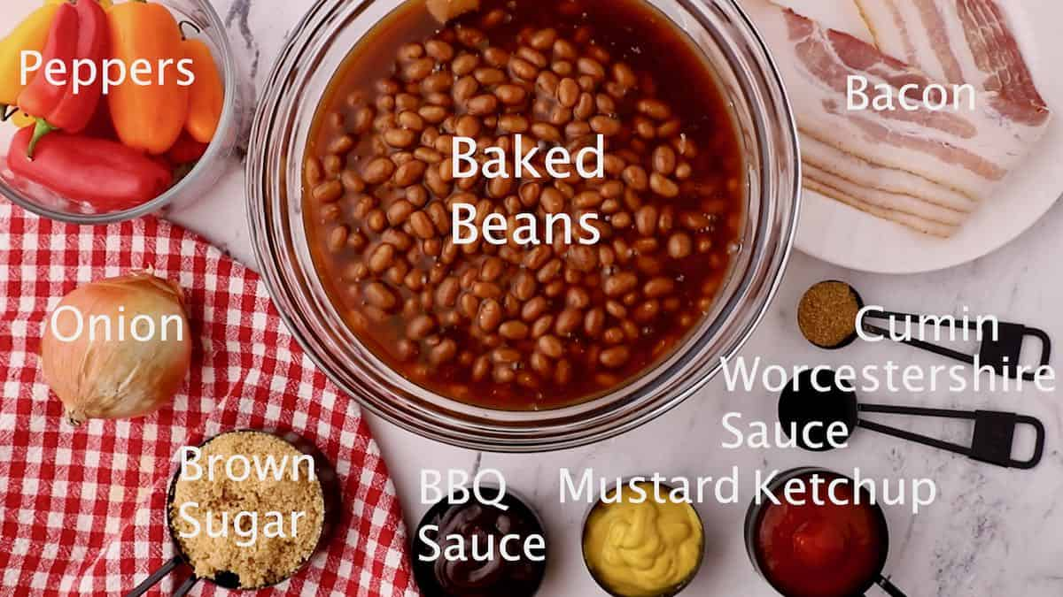 A large bowl of baked beans, ketchup, mustard, and BBQ sauce.