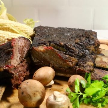 Smoked Beef Short Ribs on a cutting board.