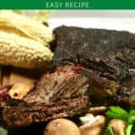 Pinterest pin showing a plate of smoked short ribs on a cutting board with mushrooms.