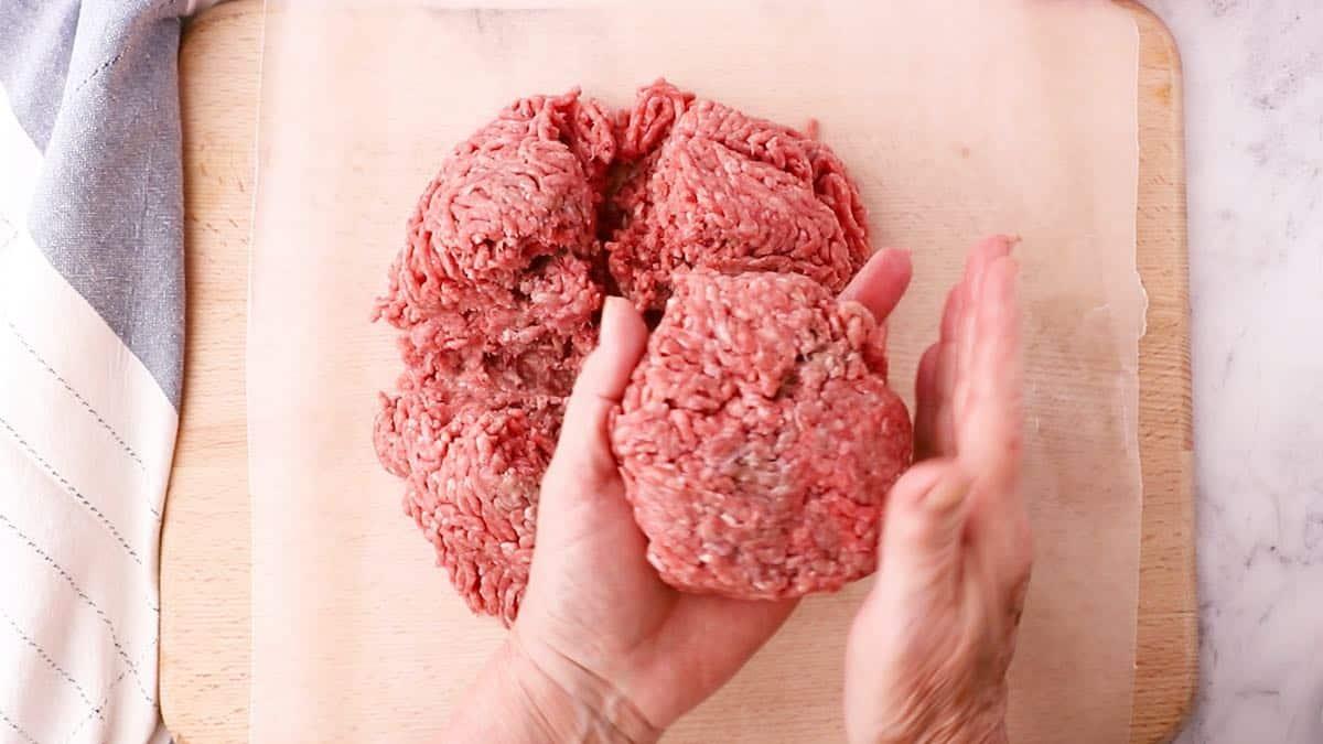 Shaping a hamburger patty by hand.