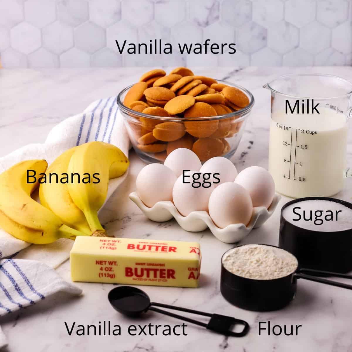 A bowl of vanilla wafers, bananas, milk and sugar.