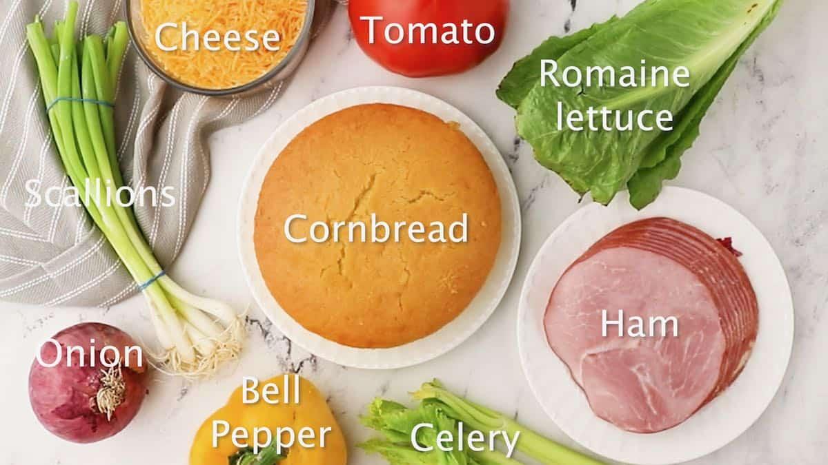Cornbread, lettuce, scallions, ham and other ingredients for cornbread salad.