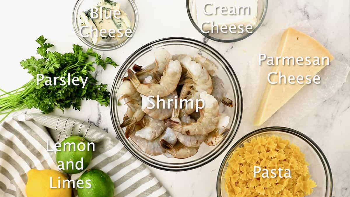 Bowls of shrimp, pasta, cream cheese, and blue cheese.
