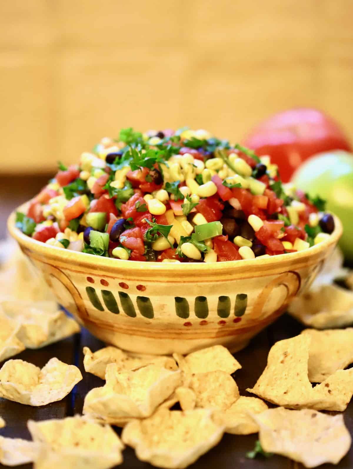 A bowl of redneck caviar dip surrounded by chips.