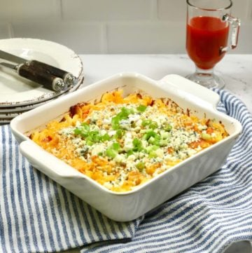 Buffalo Chicken Pasta Casserole on a blue and white kitchen towel.