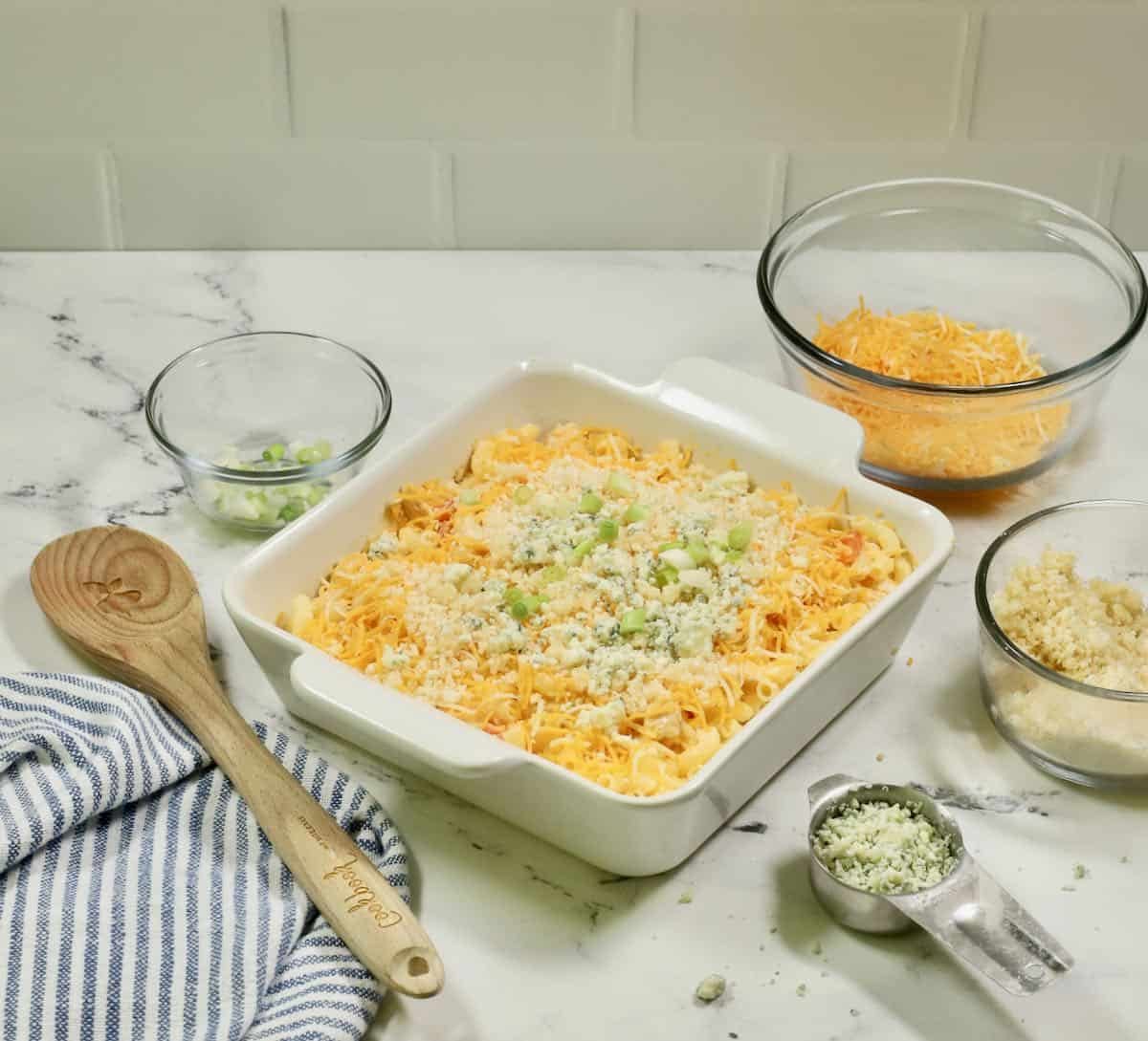 Buffalo chicken casserole topped with panko and blue cheese.