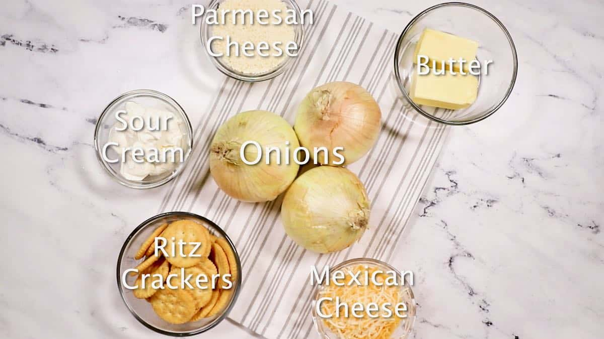 Ingredients for onion casserole including cheese and Ritz crackers.