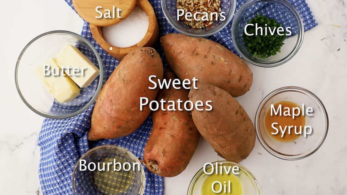 Four sweet potatoes and ingredients to make maple bourbon butter.