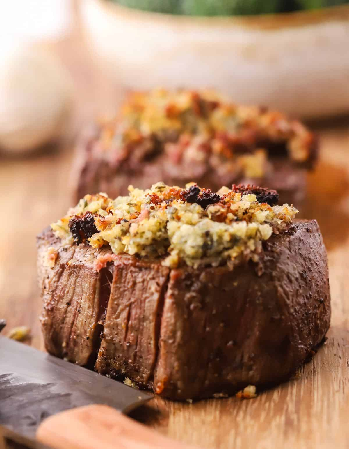 A filet mignon topped with blue cheese and panko.