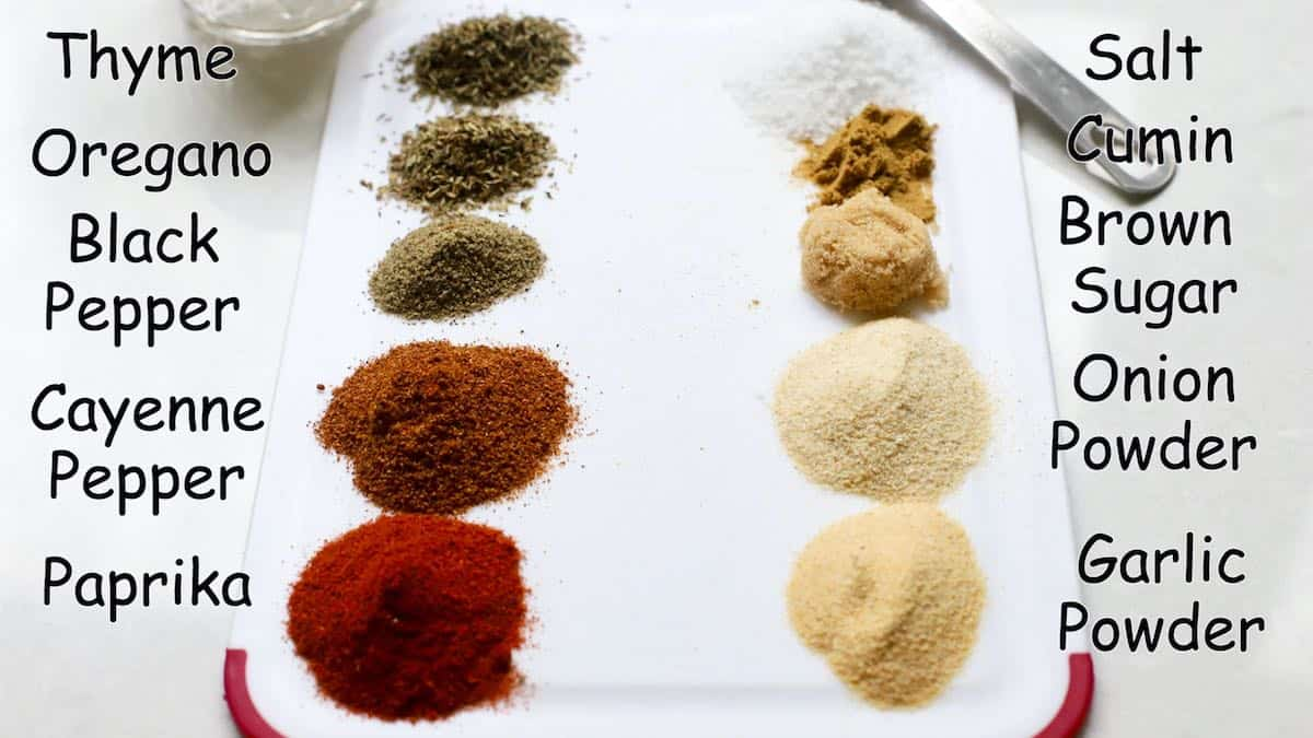 Various spices in piles on a  cutting board to make blackened seasoning.