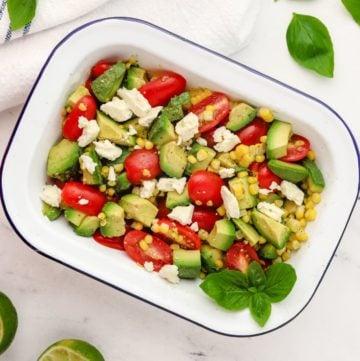 Tomato Avocado Feta Salad in a white serving dish.