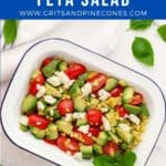 Pinterest pin showing a Tomato Avocado and Feta Salad in a white dish.
