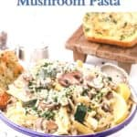 A white bowl with mushrooms and pasta.